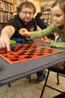 Steven helping Anya play Checkers
